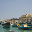 Luzzu boats in marsaxlokk maltfishing village — Stockfoto #13415766
