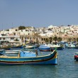 Luzzu boat marsaxlokk harbor malta - Stock Photo
