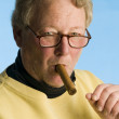 Handsome cigar smoking middle age senior man worn turtleneck shirt — Stock Photo