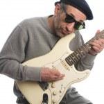 Senior man playing guitar — Stock Photo #13419012