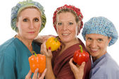Nurses promoting healthy diet with fresh colorful bell peppers — Stock Photo