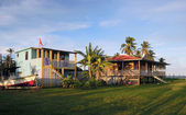 Two waterfront houses with palm trees Corn Island Nicaragua — Stock Photo