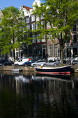 Canal scene amsterdam holland europe — Stock Photo