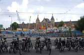 Commuter bicycles parked near centraal station amsterd — Stock Photo