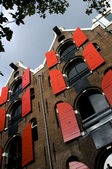 Leaning houses with hoist lifts amsterdam — Stock Photo