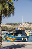 Marsaxlokk malta fishing village luzzu boat — Stock Photo