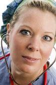 Female nurse head shot with clothing — Stock Photo