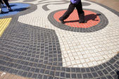 Walking tile mosaic art work on La Rambla Barcelona Spain — Stock Photo