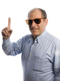 Smiling man with finger pointing number one — Stock Photo