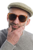 Aging artist thinking distorted nose close up scottish tweed hat — Stock Photo