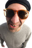 Aging artist distorted nose close up beret hat smiling happy — Stock Photo
