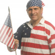 Patriotic American man wearing flag shirt with national flag — Stock Photo #13421244