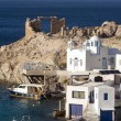 Stockfoto: Fishermhouses boat storage garages built into rock cliffs on MediterraneSeFiropotamos Milos Cyclades Greek Island Greece