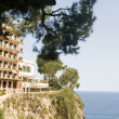 Stock Photo: Luxury apartment condos built on rocky cliff over MediterraneSeMonte Carlo Monaco