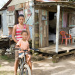 Stock Photo: Nicaragumother daughter bicycle poverty house Corn Island