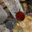 Fancy cocktail glasses and crackled glass — Stock Photo