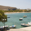 Harbor and beach PolloniMilos Cyclades Greek island Greece — Zdjęcie stockowe #13421323