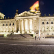The Reichstag Parliament building main entrance flags blowing night light Berlin Germany Europe — Stock Photo