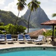 Caribbean Sea resort swimming pool view twin piton peaks mountains with coconut palm trees Soufriere St. Lucia — Stock Photo #13422004