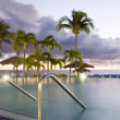 Large luxury infinity swimming pool dusk sundown hotel St. Maarten St. Martin Caribbean Island — Stock Photo #13422013
