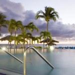 Large luxury infinity swimming pool dusk sundown hotel St. Maarten St. Martin Caribbean Island — Stock Photo