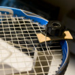 Foto de Stock  : Restring tennis racket