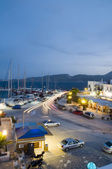 Adamas Milos Cyclades Greek island town at dusk waterfront harbour — Stock Photo