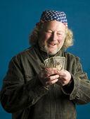 Handsome middle age man flag bandana leather jacket cash money — Stock Photo