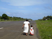 Mother daughter walking of airport runway Corn Island Nicaragua — Stock Photo