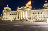 The Reichstag Parliament building main entrance flags blowing night light Berlin Germany Europe — 图库照片