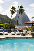 Caribbean Sea resort swimming pool view twin piton peaks mountains with coconut palm trees Soufriere St. Lucia — Stock Photo