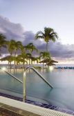 Large luxury infinity swimming pool dusk sundown hotel St. Maarten St. Martin Caribbean Island — Stock Photo