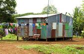 Ramshackle zinc house laundry hanging Corn Island Nicaragua — Stock Photo