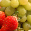 Grapes strawberries — Stock Photo