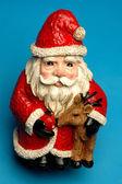 Happy ceramic santa — Stock Photo