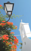 Lamp, church, flowers — Stock Photo