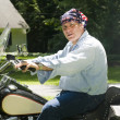 Stock Photo: Middle age man on motorcycle with american flag bandana