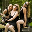 Stock Photo: Sexy group blond women on large motorcycle