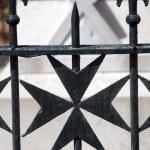 Maltese cross wrought iron fence — Stock Photo #23039734