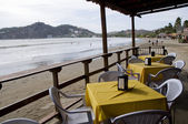 Ocean front beach thatched roof restaurant nicaragua — Stock Photo