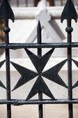 Maltese cross wrought iron fence — Stock Photo