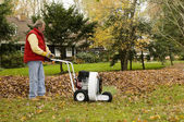 Homeowner using professional leaf blower — Stock Photo