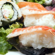 Stock Photo: sushi sashimi with california rolls