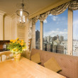 Dining table in kitchen nook penthouse new york — Stock Photo