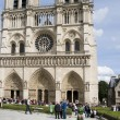 Stock Photo: Tourists at Notre Dame Cathedral Paris France