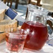 Stock Photo: Home made rose wine and crusty bread at greek island taverna