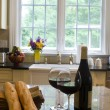 Kitchen island with wine baguettes — Stok fotoğraf