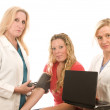Three nurses in medical scrubs clothes — Stock Photo