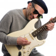 Middle age mplaying guitar musician — Stock Photo #23041462