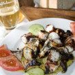 Greek island taverna specialty marinated grilled octopus — Stock Photo